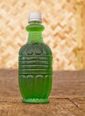 Soft drink from green crush chlorophyll water in plastic bottle — Stock Photo
