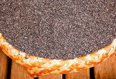 Black sesame seed in bamboo basket — Stock Photo