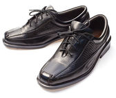 Black geniune leather businessmen's shoes on white — Stock Photo