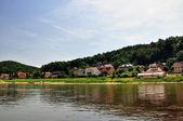 Village on river — Stock Photo