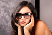 Stylish young lady in elegant sun glasses — Stock Photo