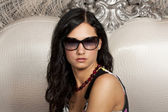 Beautiful young lady in elegant sun glasses — Stock Photo