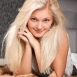 Gorgeous young girl with pretty blond hair - Stock Photo