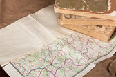 Vintage retro map and old books — Stockfoto