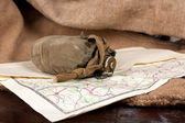 Vintage weathered flask and map — Stock Photo