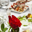 Stock Photo: Red rose on served table