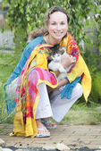 Attractive woman with a cat — Stock Photo