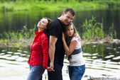 Happy family on nature — Stock Photo