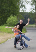 Happy couple at bicycle — Stock Photo