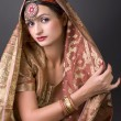 Stock Photo: Portrait with traditionl costume. Indistyle