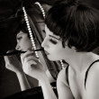 Beautiful girl with cigarette before a mirror — Stock Photo