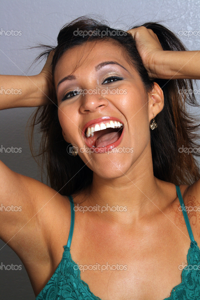 Closeup of a lovely young excited and perhaps crazed Latina with faded