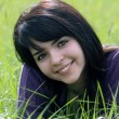 Beautiful Brunette in a Grassy Field (2) - Foto de Stock