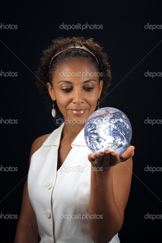 A lovely mature black woman holds the earth in the palm of her hand.  This photo is available without the earth.  Earth photo credit:  NASA, public domain. — Stock Photo #5854770