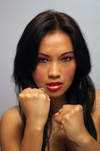 Beautiful Angry Asian Girl with Fists — Stock Photo