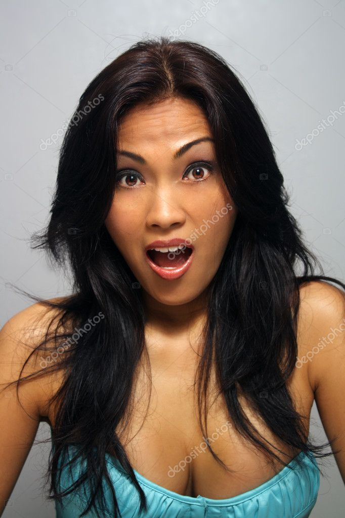 Beautiful Surprised Asian Girl - Stock Image