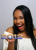 "Beautiful Haitian Girl Holds ""2012"" in her hands — Stock Photo"