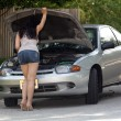 Stock Photo: Attractive Girl with Disabled Car (7)