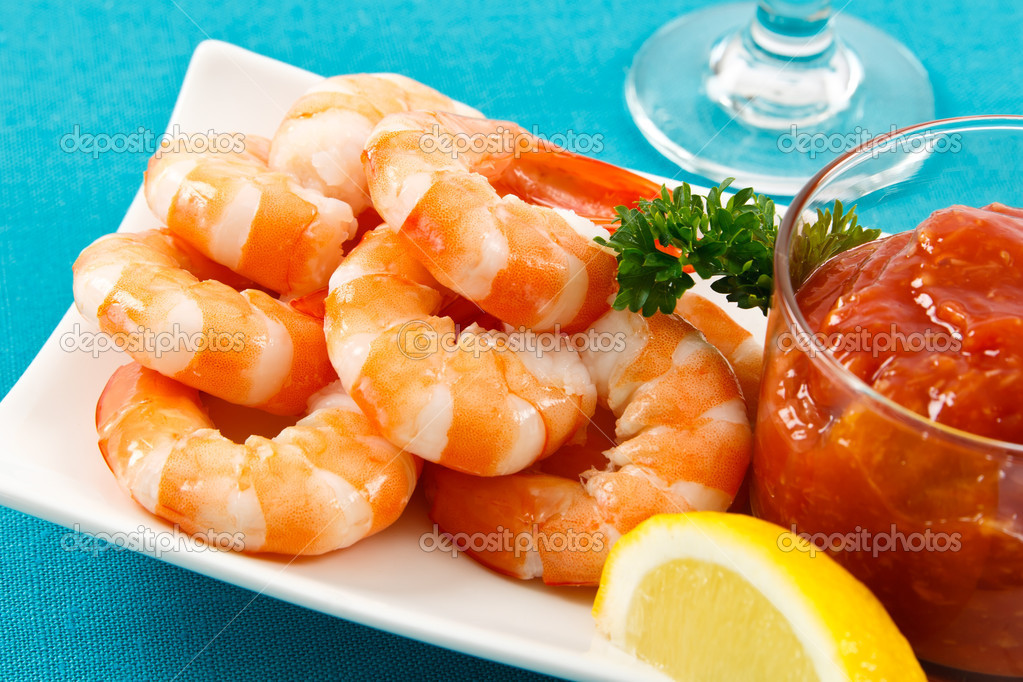 Fresh shrimp are a delicious gourmet appetizer and a dangerous food allergen.  Stock Photo #5462656