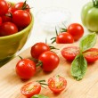 Sliced Cherry Tomatoes with Basil — Stock Photo