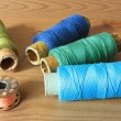 Colorful spools of thread close up on the table — Zdjęcie stockowe