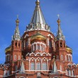 Stock Photo: Brick orthodox church with golden domes against clear sky