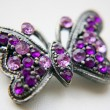 Costume jewelry in the shape of a butterfly with gems — Stock Photo