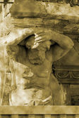 The bas-relief - an athlete holds the portico of the building — Stock Photo