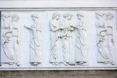 A fragment of the facade of the building with a bas-relief in the Greek style — Stock Photo
