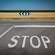 Stop signal near crossroads - Foto Stock