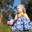 Little girl is sitting on grass — Stock Photo #5901655