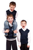 Portrait of three fun brothers in school uniform, isolation — Stock Photo