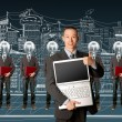 Lamp head businesspeople with laptop — Stock Photo