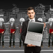 Stock Photo: Lamp head businesspeople with laptop