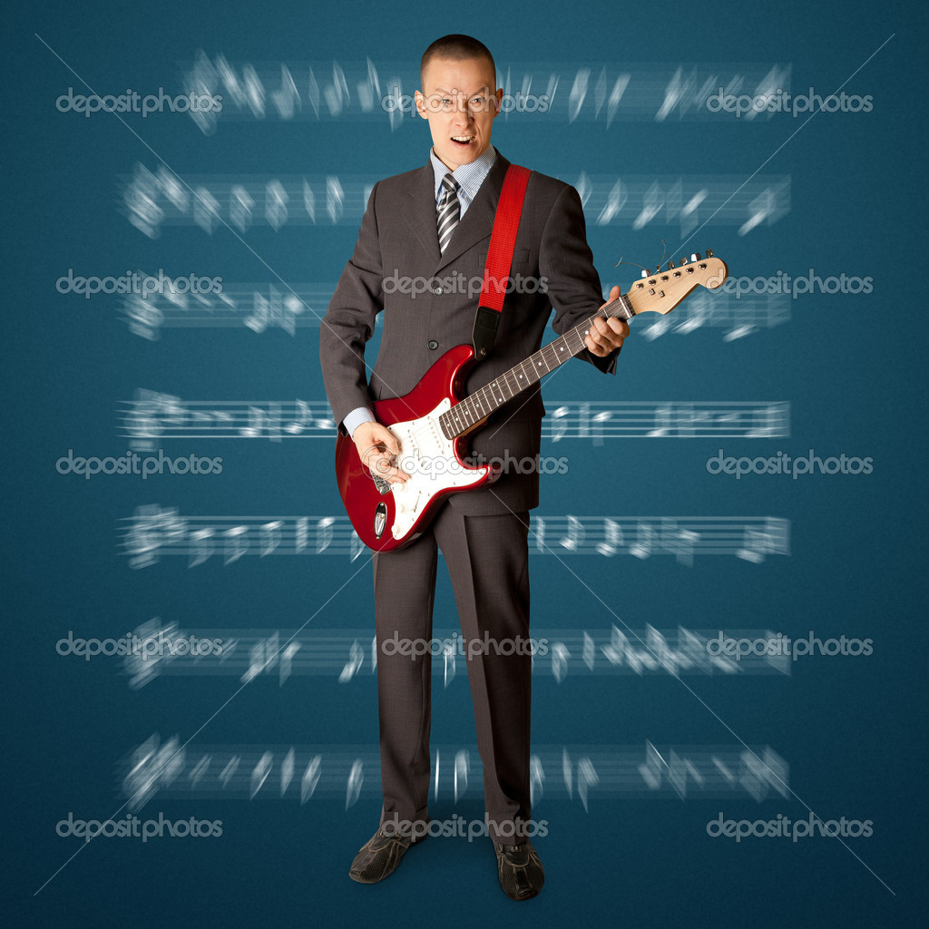 Punk man with the guitar isolated on white background — Stock Photo #5423466
