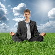 Stock Photo: Businessmin lotus pose outdoors