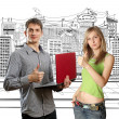 Man with laptop in his hands and woman — Stock Photo #5469657
