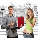 hombre con laptop en sus manos y mujer — Foto de Stock