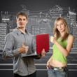 Stock Photo: Mwith laptop in his hands and woman