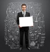 Businessman with empty write board — Stock Photo