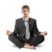 Businessman in lotus pose — Stock Photo