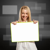 Happy businesswoman holding blank white card — Stock Photo