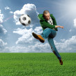 Stock Photo: Asisoccer player outdoors