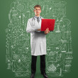 Foto Stock: Doctor male in suit with laptop in his hands