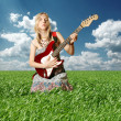Hippie girl with the guitar outdoor — Stock Photo