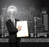 Lamp head businessman with empty write board — Stock Photo