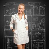 Mujer joven médico con estetoscopio — Foto de Stock