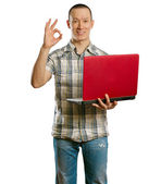 Asian male with laptop in his hands shows OK — Stock Photo