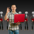 Lamp head businesspeople with laptop — Stock Photo #5685280