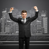 Businessman with hands up — Stock Photo